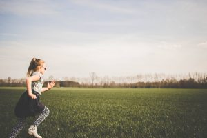 Girl running in field   Physiotherapy for osteoporosis   Vida Health & Wellness