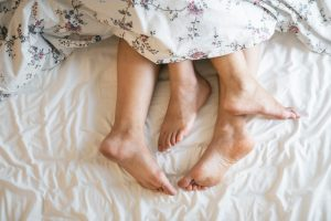 Adult feet in bed - sexual function
