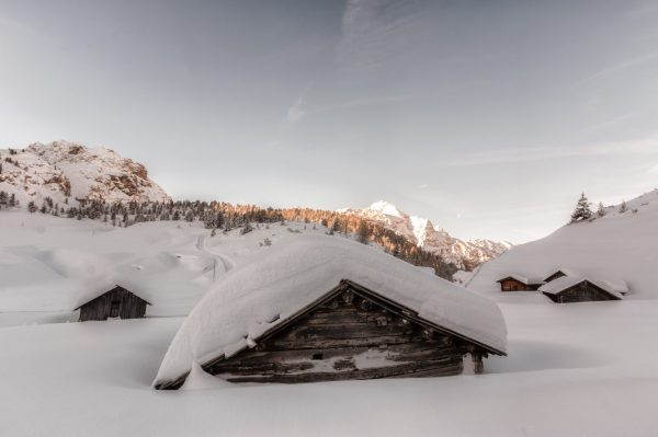 snow covered house-min